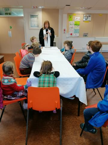 Children share Communion Dec 2019